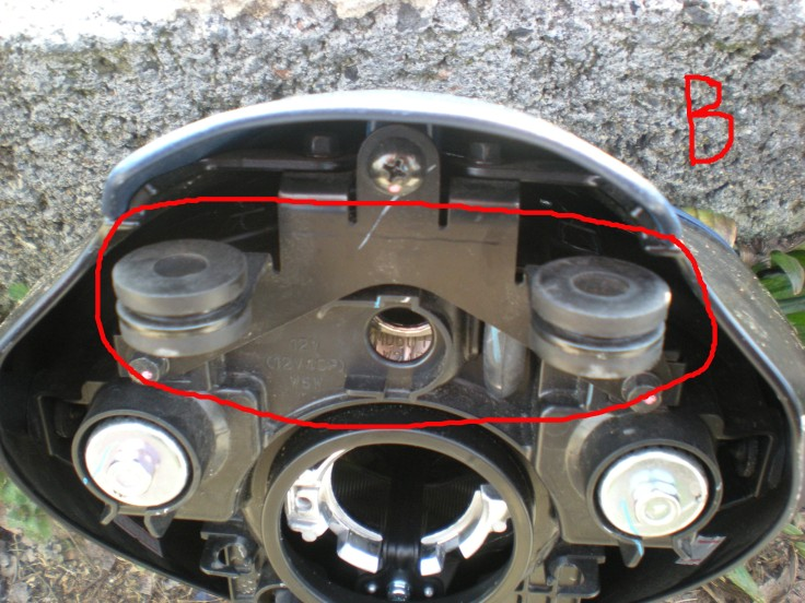 head light housing mounting post holes